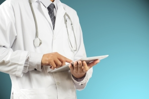 doctor with handheld mobile tablet device